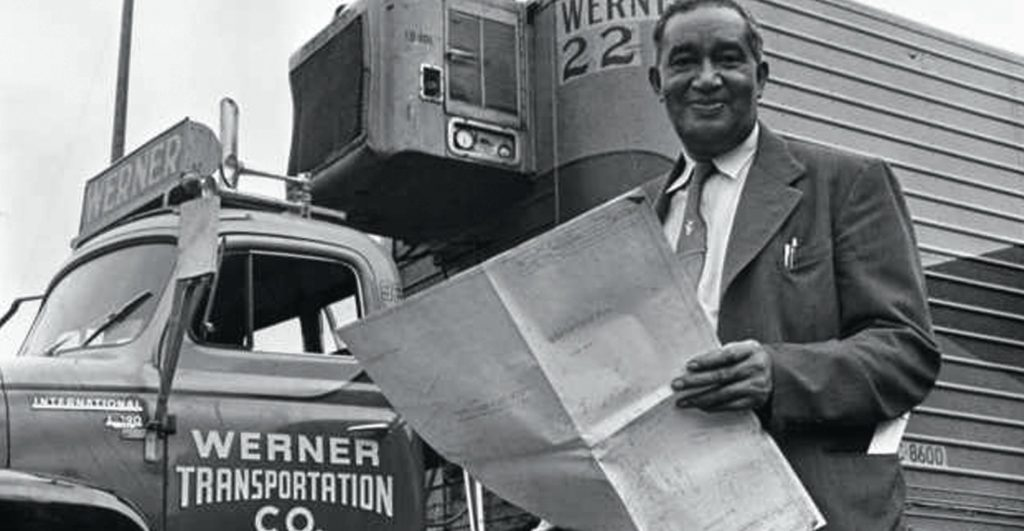 Frederick McKinley Jones standing next to a refrigerated van circa 1950