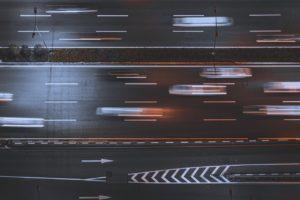 vehicles speeding by